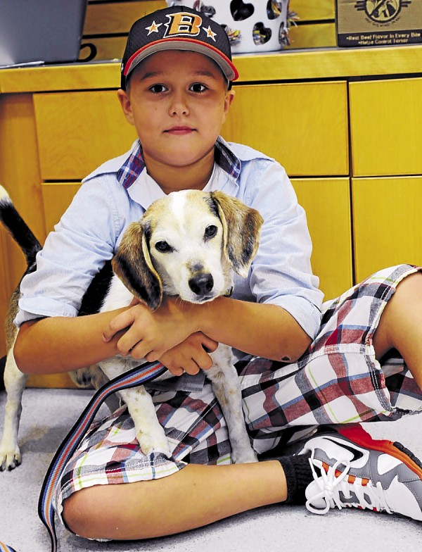 "Matthew Gross, 10, was inspired to help the Bangor Humane Society raise money to care for pets in its care after his family adopted Buddy, a 12 year old Beagle. Gross promoted and collected pledges for his 15 mile bike ride ""The Ride for the Wet Nose."" His goal was $300. He raised over $1,000. Gross and Buddy pause for a photo op at the Bangor Humane Society on Aug. 30."