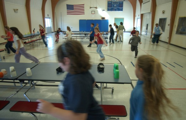 Fourth-graders run to the tables during physical education class in March 2004 at the Dr. Carl E. Troutt School in Mattawamkeag.