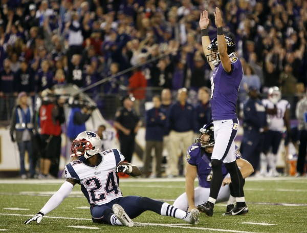 Baltimore Ravens kicker Justin Tucker (right) celebrates his game-winning field goal over the New England Patriots at the end of their NFL game in Baltimore, Md., Sunday night, Sept. 23, 2012. Also pictured is New England Patriots cornerback Kyle Arrington (24) and Ravens holder Sam Koch.