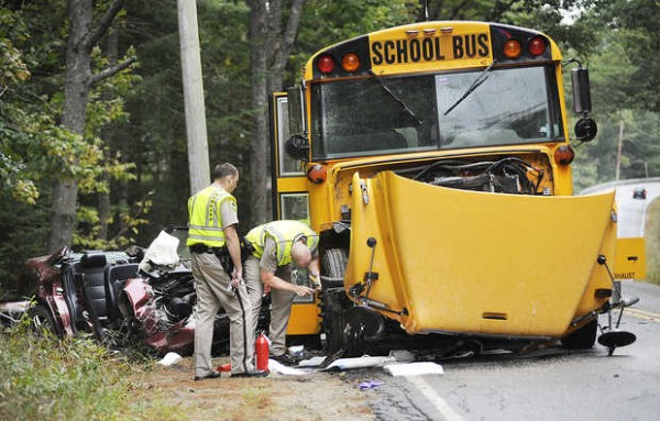 Oxford County Sheriff's Department officers investigate the scene of an accident on Route 119 in Hebron involving an Oxford Hills school bus and an Audi automobile on Tuesday afternoon, Sept. 18, 2012. Emergency workers used the Jaws of Life to remove the roof the car to extricate the driver, 19-year-old Brandon Buffington of Paris.