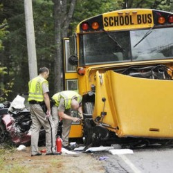 8 students, driver injured in collision of school bus, car in Hebron