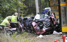 Oxford County Sheriff Department officers investigate the scene of an accident on Rt 119 in Hebron involving a school bus from the Oxford School District and an Audi automobile on Tuesday, Sept. 18, 2012.