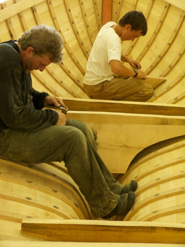 Richard Stanley and apprentice Ryan Snow fitting floor timbers