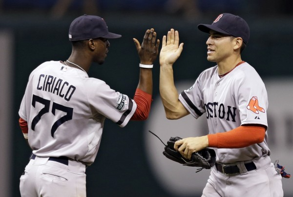 Boston Red Sox's Jacoby Ellsbury, right, high-fives teammate Pedro Ciriaco after the team defeated the Tampa Bay Rays 5-2 during a baseball game, Monday, Sept. 17, 2012, in St. Petersburg, Fla.