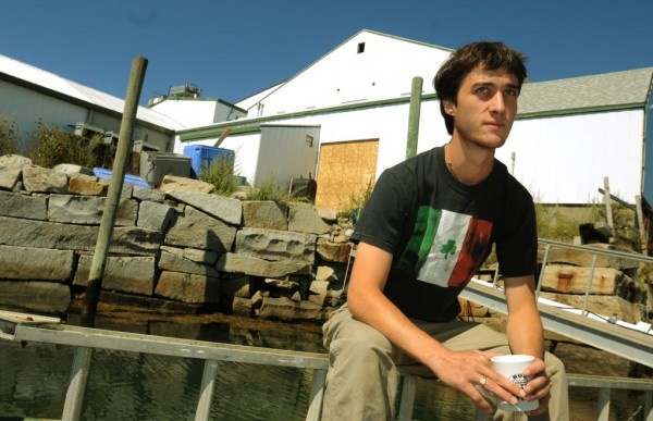 Kyle Murdock sits on a dock in front of the Sea Hag lobster processing plant he runs in St. George on Wednesday, Aug. 30, 2012.