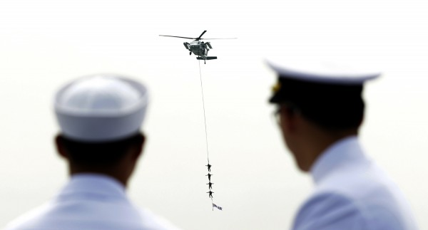 South Korean Special Navy seamen hang on the rope from a helicopter during the 62nd Incheon Landing Operations Commemoration ceremony in waters off Incheon, South Korea Saturday, Sept. 15, 2012. Incheon is the coastal city where United Nations Forces led by U.S. General Douglas MacArthur landed in September, 1950 just months after North Korea invaded the South.