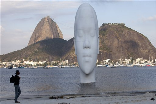&quotAwilda&quot, a sculpture by Spanish artist Jaume Plensa, emerges from Guanabara Bay in Rio de Janeiro, Brazil, Monday, Sept. 3, 2012. Awilda, a 12-meter-high sculpture depicting a woman, is part of the art exhibition &quotOIR&quot or Other Ideas for Rio where installations will be placed in public places.