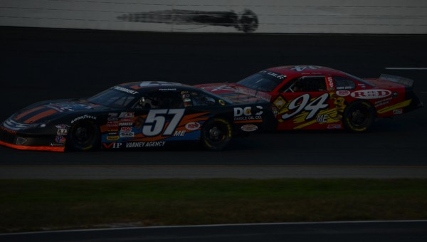 Austin Theriault of Fort Kent (57ME) races inside of Shawn Martin of Turner during the American-Canadian Tour Invitational at New Hampshire Motor Speedway in Loudon, N.H. on Saturday, Sept. 22, 2012. Theriault placed 15th while Martin was 13th.