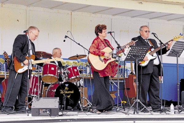 Among the live local entertainment appearing during the Sept. 8 Wheels on the Waterfront car show in Bangor was the Wildwoods Band, which performs Maine country music.