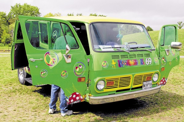 "Owned by Brooke Green of Hermon, this 1969 GMC Van recalls the ""Summer of Love"" in 1969 and the Woodstock, N.Y. concerts that shaped a generation. For passersby at the Sept 8 Wheels on the Waterfront car show held in Bangor, the van was an attention-getter."
