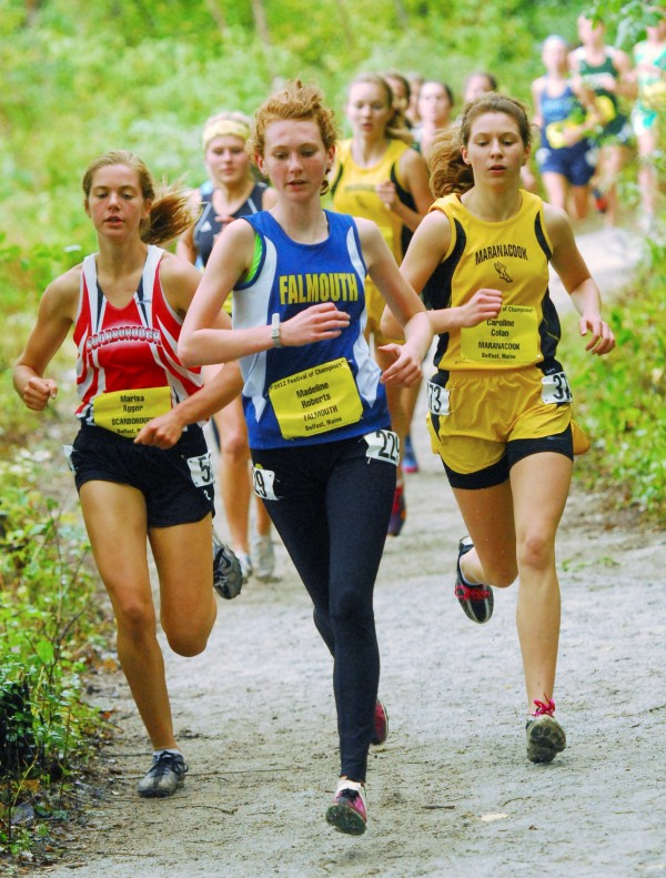 Marisa Agger of Scarborough (from left), Madeline Roberts of Falmouth, and Caroline Colan of Maranacook stay close during the early minutes of the Cross Country Festival of Champions at the Troy Howard Middle School in Belfast, Saturday, Sept. 29 2012.