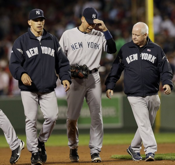 New York Yankees' Derek Jeter leaves the game with manager Joe Girardi, left, and team trainer Steve Donohue , right, after he was injured trying to beat out a grounder during the eighth inning of a baseball game against the Boston Red Sox at Fenway Park in Boston Wednesday, Sept. 12, 2012.