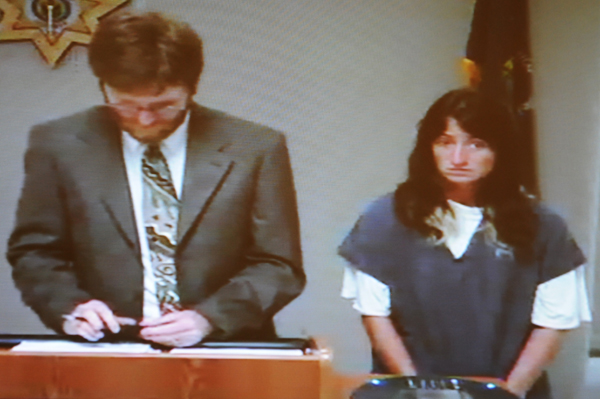Stephanie Carey (right) makes her first appearance on the charges of stealing a car with lawyer of the day Sean Ociepka (left) at Penobscot Judicial Center on Tuesday, September 4, 2012.