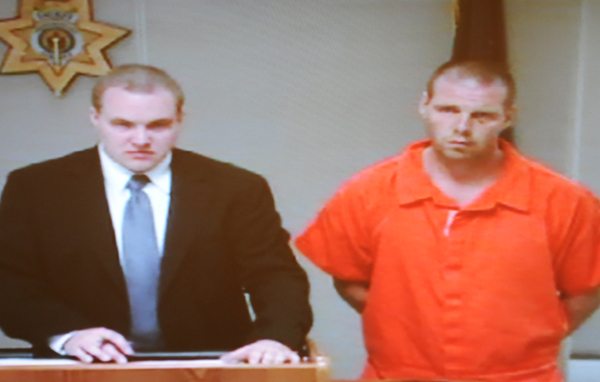 Bruce Allen Carey (right) makes his first appearance on the charges of stealing a car with lawyer of the day Benjamin Fowler (left) at Penobscot Judicial Center on Tuesday, September 4, 2012.