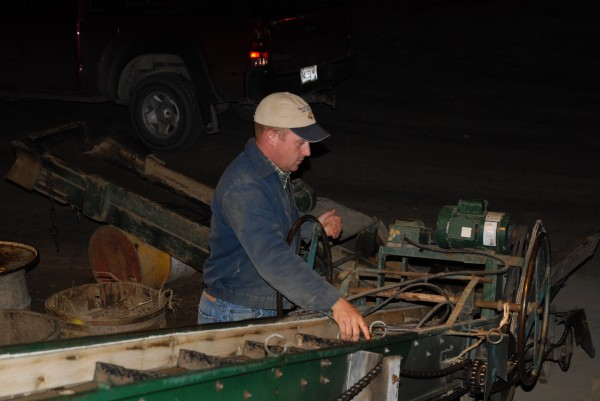 In the pre-dawn hours Kris Malmborg makes sure everything is ready to go for another day of harvesting at his grandfather's potato storage shed in Fort Kent.