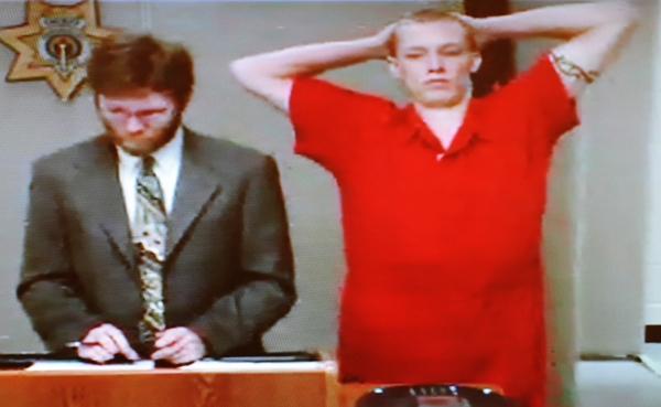 Nicholas Hutchinson stands with attorney Sean Ociepka at Penobscot County Jail on Tuesday, September 4, 2012, during his initial video appearance in connection with a home invasion on the East Ridge Road in Greenbush on Sept. 3.