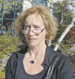 &quotWorking in my garden.&quot — Irma Smith, Van Buren