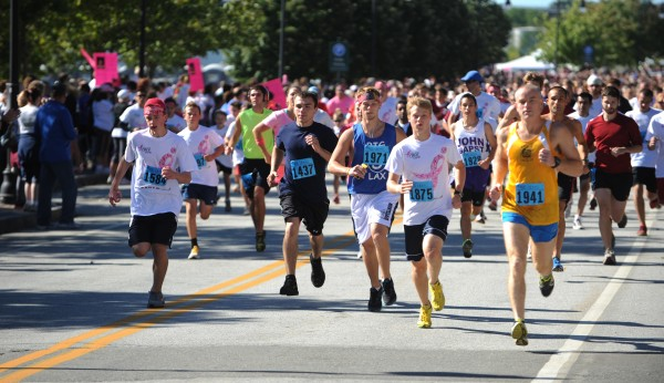 Runners in the 16th annual Susan G. Komen race for the cure run down Front Street in Bangor on Sunday, Sept. 16, 2012.