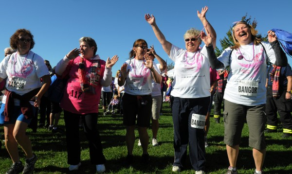 Walkers and runners in the 16th annual Susan G. Komen Race for the Cure road race warm up to salsa music along the Bangor Waterfront on Sunday, Sept. 16, 2012.