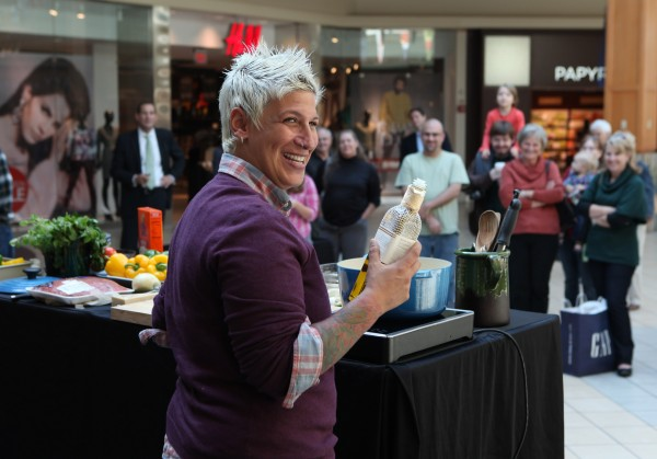 Food Network's Michelle Ragussis smiles during a cooking demonstration Thursday, Sept. 27, 2012 at the Maine Mall in South Portland, Maine.