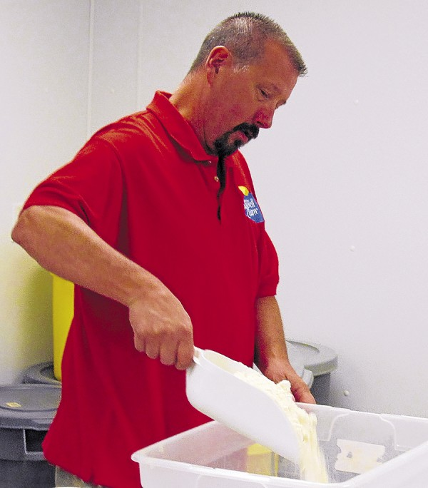 Jim Collins starts one of the many mixes offered by New England Cupboard in Hermon.
