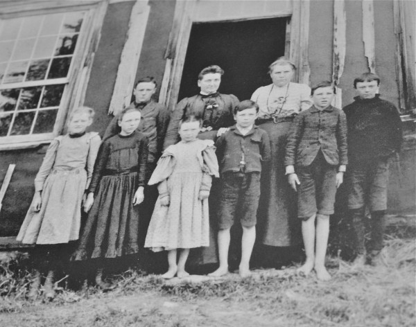 The first student s of Greenville. From left to right in front; Mary Curtis, Eva Shaw, Florence Shaw, Hartwell Shaw, Noel Shaw and Stan Walden. In rear from left: Harold Walden and teacher Sibbyl Paine and Nora Hilton. Photo courtesy of the Moosehead Historical Society and Museum.