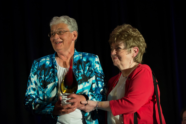 Jeannette Morrill of Shirley (left) was honored in June in Florida with the Outstanding PH Citizen Award given by the Pulmonary Hypertension Association for her work to raise awareness of the disease. Presenting the award is Merle Reeseman, a PH patient from Pennsylvania.