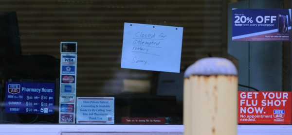 A handwritten closed sign is seen on Sunday, Sept. 30, 2012, in the drive-up window at the Brewer Rite Aid on Wilson Street.