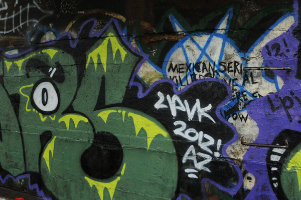 Graffiti on a cement wall in downtown Bangor as seen on Wednesday, September 5, 2012.