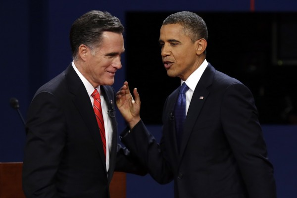 Republican presidential candidate former Massachusetts Gov. Mitt Romney and President Barack Obama talk after the first presidential debate at the University of Denver in Denver.