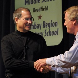 Then-Maine Gov. Angus King (right) greets Apple CEO Steve Jobs, during a visit to Portland High School in June 2002.