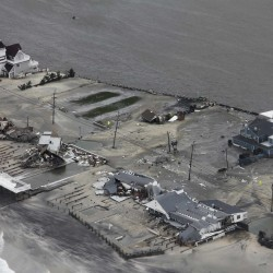 "Damage after Hurricane Sandy made landfall on the southern New Jersey coastline is seen in this U.S. Coast Guard handout photo in Brigantine, New Jersey, Oct. 30, 2012. In the storm's wake, Obama issued federal emergency decrees for New York and New Jersey, declaring that ""major disasters"" existed in both states. One disaster-forecasting company predicted economic losses could ultimately reach $20 billion, only half insured."