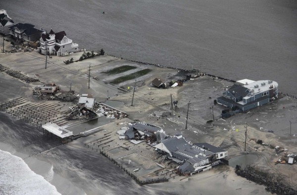 Damage after Hurricane Sandy made landfall on the southern New Jersey coastline is seen in this U.S. Coast Guard handout photo in Brigantine, New Jersey, Oct. 30, 2012. In the storm's wake, Obama issued federal emergency decrees for New York and New Jersey, declaring that &quotmajor disasters&quot existed in both states. One disaster-forecasting company predicted economic losses could ultimately reach $20 billion, only half insured.