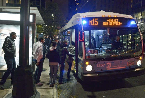 This photo provided by Metropolitan Transportation Authority shows people boarding a bus, as partial bus service was restored on Tuesday, Oct. 30, 2012. Mass transit, including buses, was suspended during Sandy, the storm that made landfall Monday.