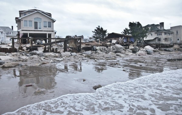 A beachfront house is damaged in the aftermath of yesterday's surge from superstorm Sandy, Tuesday, Oct. 30, 2012, in Coney Island's Sea Gate community in New York.