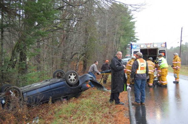 Samuel T. Flagg, 19, of Livermore Falls is carried to an ambulance from his overturned car on Campground Road in Livermore Falls on Tuesday afternoon, Oct. 30, 2012.