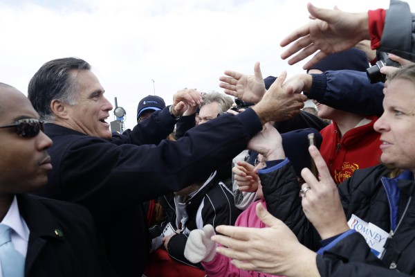 Republican presidential candidate, former Massachusetts Gov. Mitt Romney greets supporters after he spoke about the economy at a campaign rally at Kinzler Construction Services in Ames, Iowa, Friday, Oct. 26.