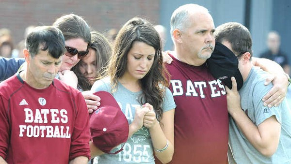Some of the friends, family and faculty that were gathered on the Bates College football field Saturday afternoon, Oct. 6, 2012, comfort each other during a moment of silence for Troy Pappas, 18, of Eliot, who died Friday from a stairwell fall six days earlier.