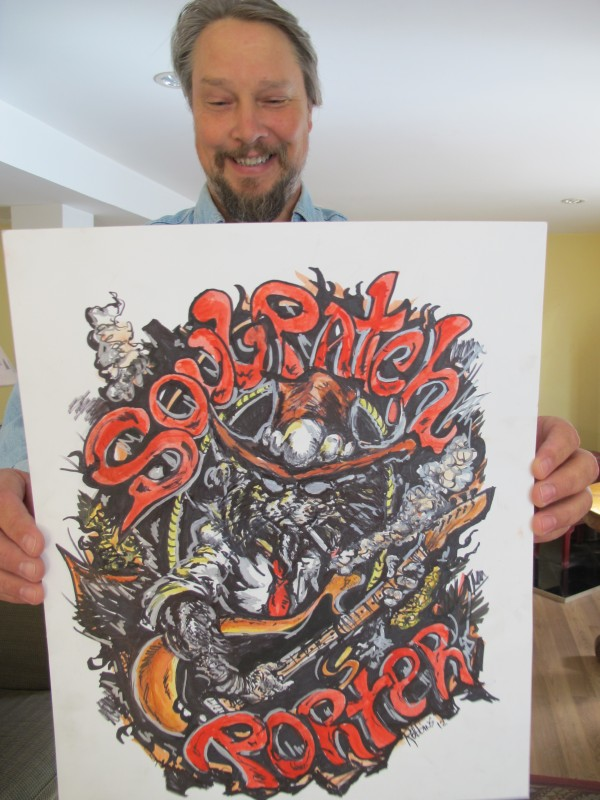 Al Strong of the Sedgwick-based Strong Brewing Co. holds up a piece of artwork on Wednesday, Oct. 17, that will be the logo for one of his flagship beers: Soul Patch Porter.