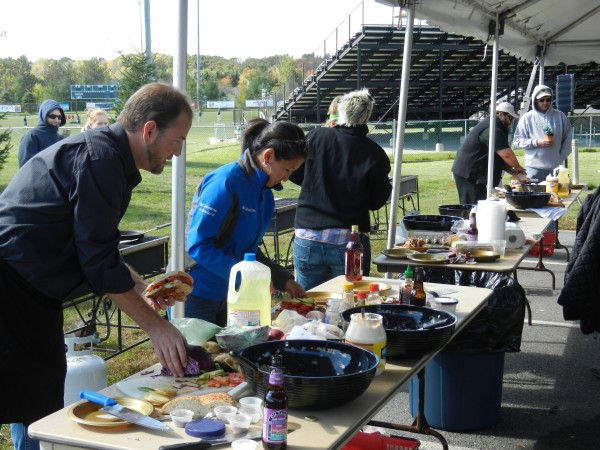 Husson University hosted its first Top Chef Tailgate Cook-off as part of the weekend's Homecoming activities on Saturday afternoon. Melissa Kim (second from left) was the eventual runner-up.
