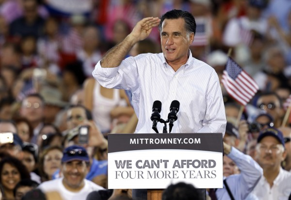 Republican Presidential candidate and former Massachusetts Gov. Mitt Romney salutes to the crowd during a campaign speech Friday, Oct. 5, 2012, in St. Petersburg, Fla.