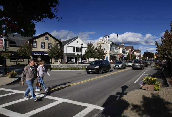 A couple crosses Main Street in downtown Kennebunk in October.