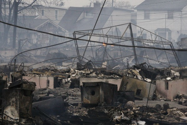 Homes damaged by a fire at Breezy Point, in the New York City borough of Queens, smolder Tuesday, Oct. 30, 2012.