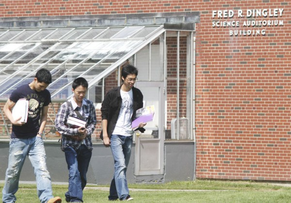 Asian students at Lee Academy walk across campus in September 2009.