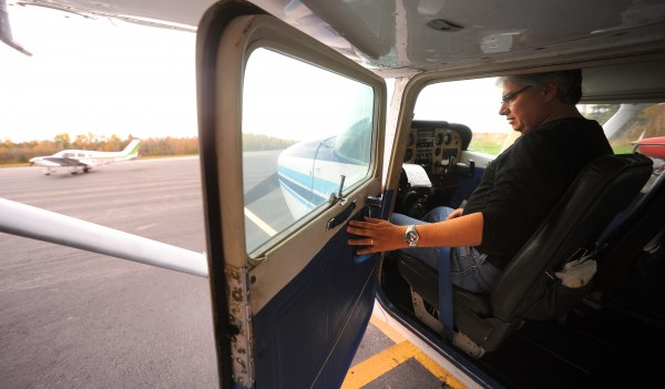 Paul Chacon of Rockport prepares for a flight with Maine Scenic Airways Inc. flight instructor Sandy Reynolds (not pictured) at the Belfast Municipal Airport Friday, Oct. 19, 2012. Chacon is a licensed pilot who is working on his instrument rating. He believes airports are important for communities to attract more business.