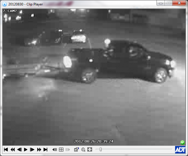 Surveillance image of a theft of a lawn tractor.