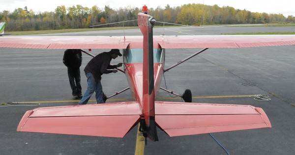 Weylon Wolph, 35, of Thorndike locks the airplane door after a flight from Belfast Municipal Airport Friday, Oct. 19, 2012. Wolph made his first solo flight about a year ago and now has a private pilot's license. He hopes to get a commercial pilot's license.