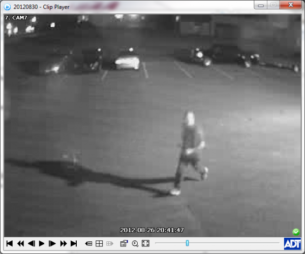 Surveillance images of a theft of a lawn tractor.
