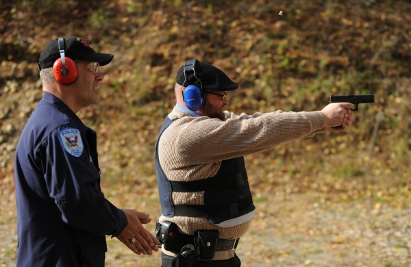 Kelvin Mote, firearms training officer for the Ellsworth Police Department, walks BDN reporter Mario Moretto through the standard police officer sidearm qualifications at the police department's firing range.