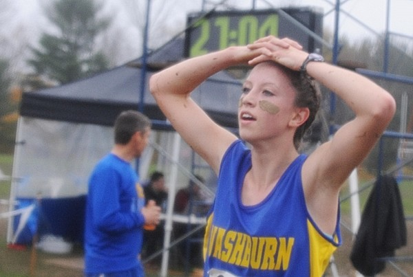 Carsyn Koch of Washburn High School catches her breath after winning the Eastern Maine girls' class C cross country title in Belfast on Saturday, Oct. 20, 2012